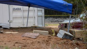 A tent covers the entrance to the underground bunker where the five-year-old boy, known as Ethan, was rescued by law enforcement  4  February 2013