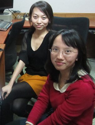"Huang Yuanyuan (front right) and a fellow ""leftover"" colleague, Wang Tingting, at their radio station in Beijing"