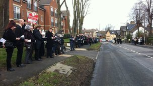People lining street close to St Saviour's church for funeral of Alan Greaves.