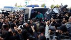 The body of Shokri Belaid, a prominent Tunisian opposition politician, is carried into an ambulance after he was shot, in Tunis
