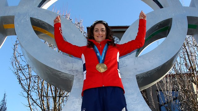 Amy Williams celebrates with her Gold Medal