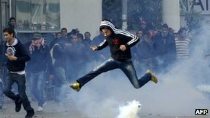 Tunisian protester jumps amid smoke after police fired tear gas outside the interior ministry - 6 February 2013