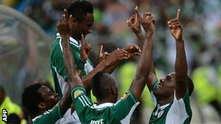 Nigeria celebrate their third goal