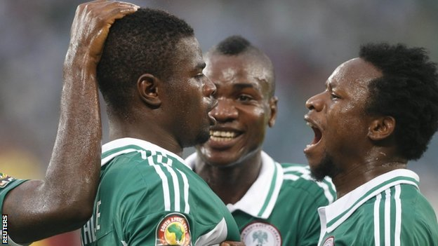 Elderson Echiejile is congratulated by team-mates after openign the scoring for Nigeria