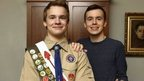 Pascal Tessier, 16, center and his brother Lucien Tessier, 20, pose for a portrait