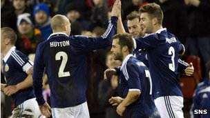 Scotland celebrate Charlie Mulgrew's 38th-minute strike