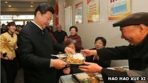 Xi Jinping being served food in a canteen