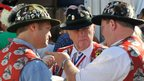 Three men in hats with badges on