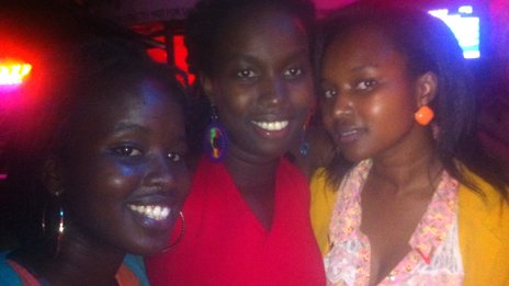 Jacky Kemisiga (L) and her friends on a night out