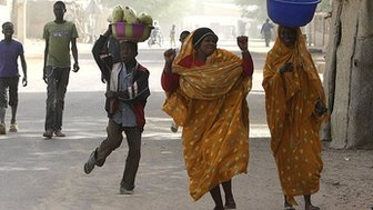 People dance in the street in Timbuktu