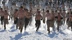 Marines running topless in snow