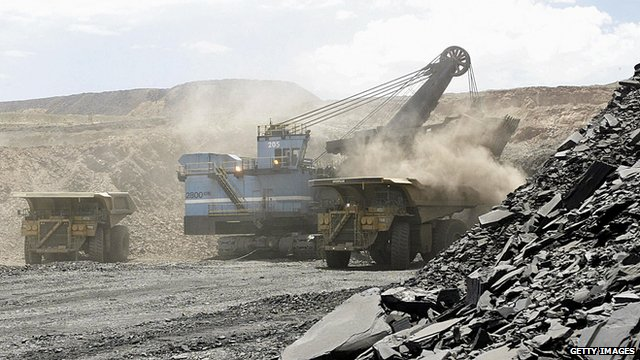 A hydraulic shovel loads a truck at an open cast diamond mine in Botswana
