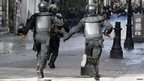 Riot police charge demonstrators in Tunis 
