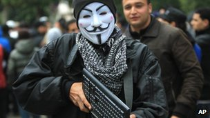A demonstrator holds a computer keyboard during a demonstration in Tunis, Thursday 7 February 2012