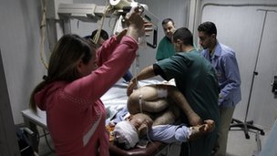 Wounded man injured in artillery shelling treated in Homs hospital, January 2012