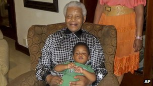 Photo taken on 2/2/13 of Nelson Mandela with his great-grandson Zen Manaway at home in Johannesburg