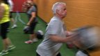 Ray Smith exercises with a medicine ball