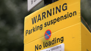 Suspended parking sign