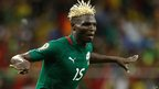 Burkinabe striker Aristide Bance celebrating with this arms outstretched in the stadium in Nelspruit, South Africa - Wednesday 6 February 2013