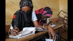 Girls pictured in classroom, one veiled, in Gao, Mali - Monday 4  February 2013