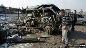 A destroyed car at the scene of Baghdad's bomb blasts. Photo: 8 February 2013