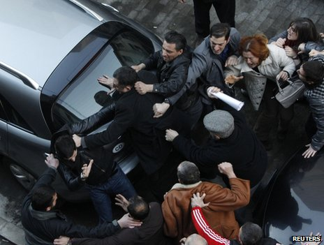Demonstrators scuffle outside the national library in Tbilisi, 8 February