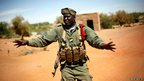A Malian soldiers tells journalists not to film the entrance of Gao, northern Mali