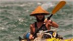 Jason Lewis in a kayak