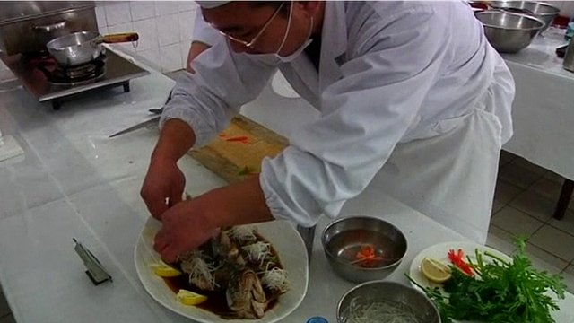 A North Korean chef preparing his signature dish