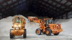 Sanitation workers use tractors to pile up salt at a depot, in New York 8 February 2013