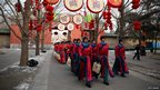 Paramilitary police re-enact an ancient ceremony for good luck, at the Temple of Earth park in Beijing, 9 Feb