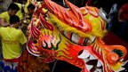 Dragon dancers practice in Manila's Chinatown district of Binondo, 9 Feb