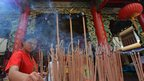 Incense-burning at Chinese temple, Bangkok, 9 February