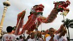 Ethnic Cambodian Chinese perform a dragon dance at the Royal Palace in Phnom Penh, 9 Feb