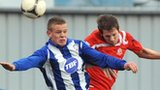 Coleraine's Aaron Canning beats Portadown opponent Richard Lecky to the high ball