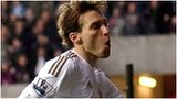 Michu celebrates for Swansea against QPR