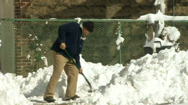 Man shovelling snow in New York