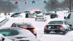 Cars stranded on snow-covered roads on Long Island (9 February 2013)