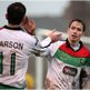 Stephen Carson congratulates David Howland who scored Glentoran's fifth goal in their Irish Cup win away to Bangor