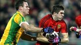 Donegal's Neil McGee tackles Connaire Harrison of Down
