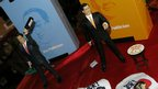 "Model figures of Hong Kong Chief Executive Chun-ying ""CY"" Leung (R) and his former rival Henry Ying-yen Tang (L)"