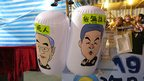 "Inflated hammer featuring Hong Kong Chief Executive Chun-ying ""CY"" Leung (R) and his former rival Henry Ying-yen Tang (L)"