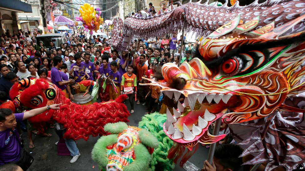 dragon and lion dancers perform in manila in the philippines 10 february 2013 - Chinese New Year Celebration