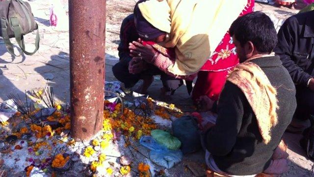 Pilgrims set up a makeshift temple