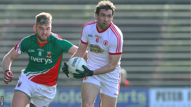 Mayo's Aidan O'Shea attempts to dispossess Joe McMahon of Tyrone