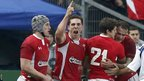 George North celebrates with his Wales team-mates as they beat France 16-6 in the Six Nations at the Stade de France