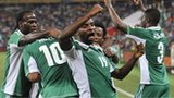 Nigeria's Sunday Mba (centre) celebrates after scoring against Burkina Faso