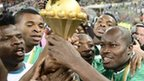 Nigeria's players hold the Africa Cup of Nations trophy aloft after their 1-0 victory over Burkina Faso in Johannesburg on Sunday