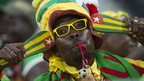 A Togo fan celebrates the Sparrow Hawks' first qualification to the knock-out phase at the seventh attempt