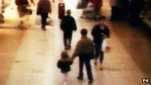 CCTV image of James Bulger being led from the shopping centre in 1993